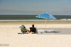 couple sitting at a beach